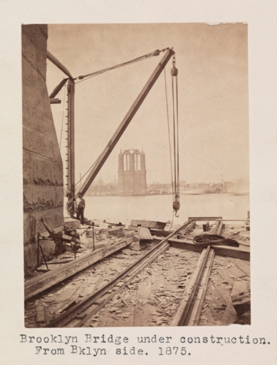 1875 Photo showing the height of the towers compared to the Manhattan Landscape.